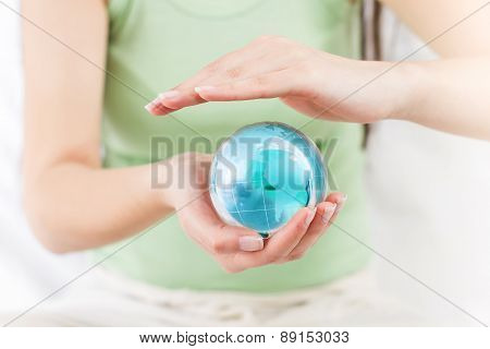 Earth Globe In Human Hands