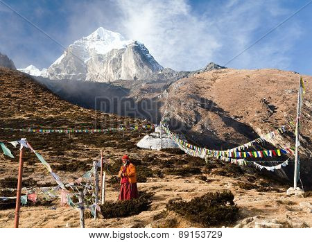 Buddhist Monk, Stupa And Prayer Flags Near Pangboche