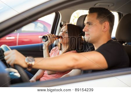 Latin Couple Drinking In A Car
