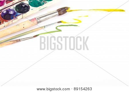 brush with paint isolated on white background