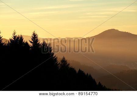 Sunset Over Misty Mountains