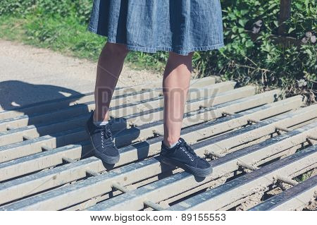 Woman Walking On Cattle Grid