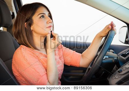 Driving A Car While Putting Makeup On