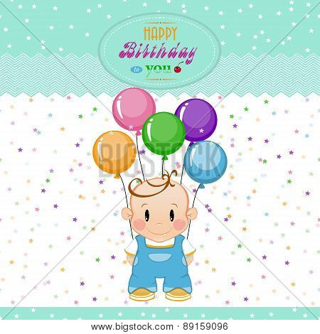 little boy with inflatable balls and stars. The birthday child