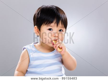 Baby boy learn to eat the finger food