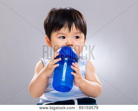 Lovely boy drinking water