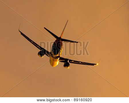Airplane leaving airport at the sunset