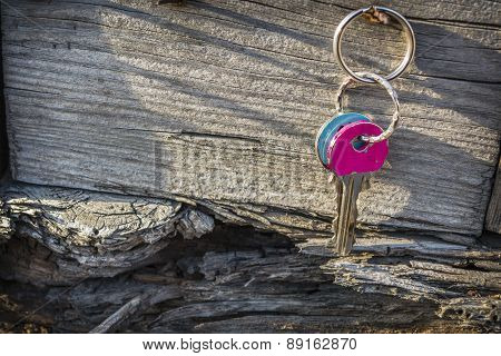 Keys Hanging On Old Wooden Wall