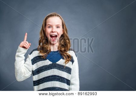 Cute Girl With Surprising Expression Against Dark Background.