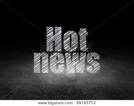 News concept: Hot News in grunge dark room