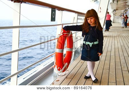 Little Girl Standing On Deck Of Cruise Ship