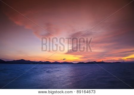 Sunset At The Beach And The Mountains