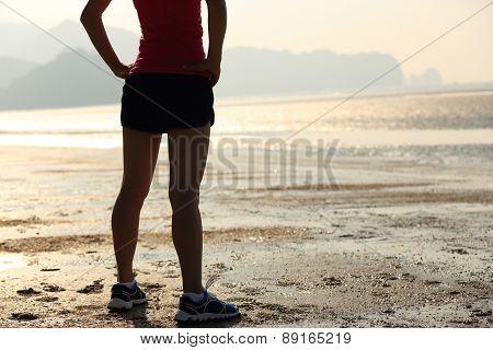 young asian woman runner on beach