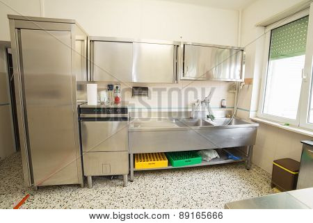 Industrial Kitchen With Refrigerator, Dishwasher And Sink