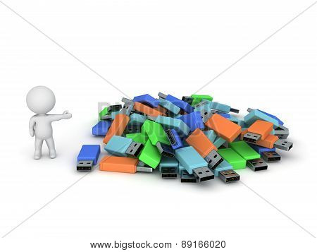 3D Character Showing Pile of USB Sticks