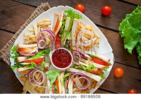 Club sandwich with cheese, cucumber, tomato, smoked meat and salami. Served with French fries.