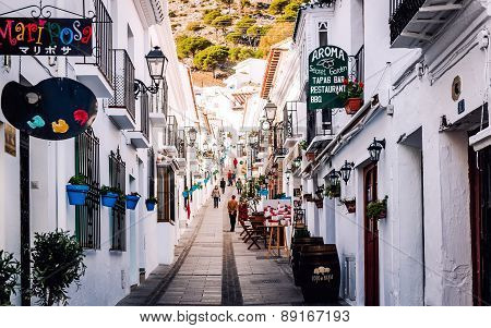Mijas, Spain- January 05, 2014: Tourists Walking In The Charming Whitewashed Narrow Street In Mijas.