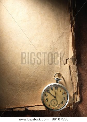 Vintage clock on the very old paper