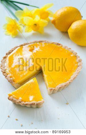 Tasty homemade sweet fruit tart pie with lemon cream filling