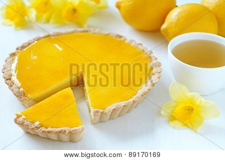 Delicious homemade lemon tart pie with green tea