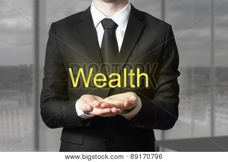Businessman Offering Wealth With Open Hands