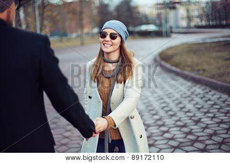 Happy girl flirting with her boyfriend in park