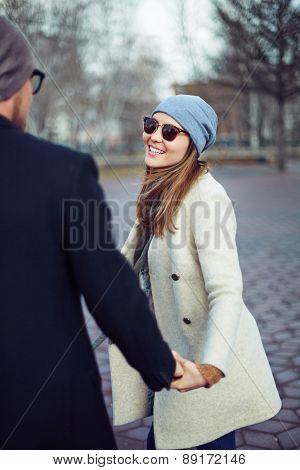 Stylish girl flirting with her boyfriend outdoors