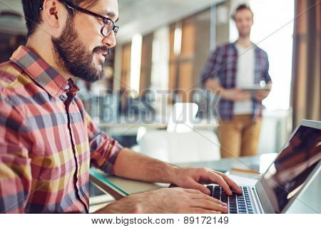 Handsome businessman networking in office