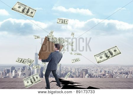 Businessman carrying bag of dollars against cracked balcony overlooking city