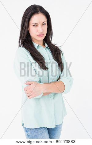 Serious woman looking at camera on white background