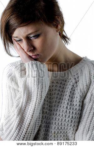 Pretty brunette feeling sad on white background
