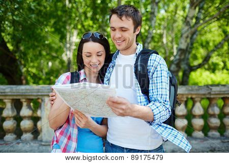 Young travelers learning guide during journey