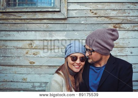 Happy young dates on background of old building