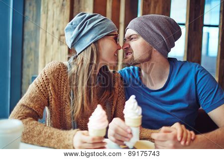 Funny dates with ice-cream spending time in cafe
