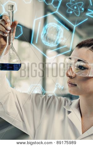 Science and medical graphic against portrait of a young science student looking at a blue liquid