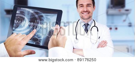 Man using tablet pc against sterile bedroom