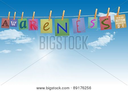 Autism awareness day against digitally generated grey background