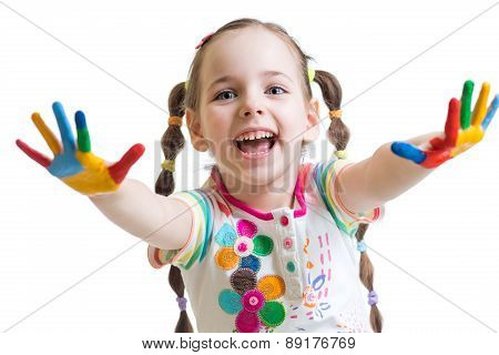 smiling child girl with colorful hands in paints on white