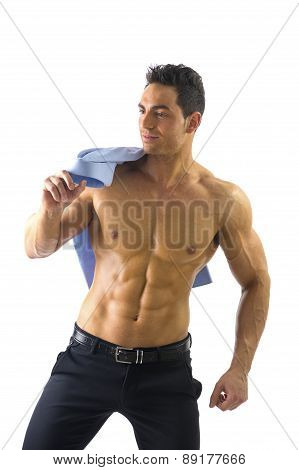 Muscular Shirtless Man Holding His Shirt On Shoulder