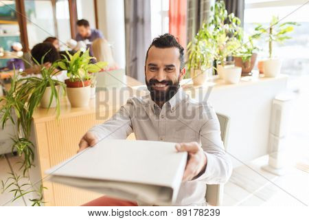 business, startup and people concept - happy businessman or creative male office worker giving folder