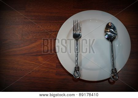 White Empty Plates With Fork And Spoon