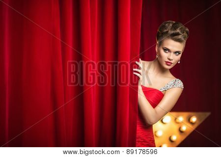 Beautiful girl behind the curtain