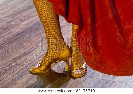 dancer legs performing on stage on high heels red dress