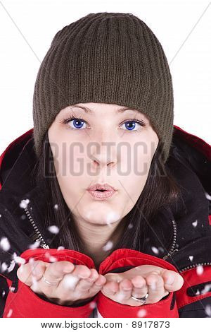 Woman Blowing Soft White Flakes