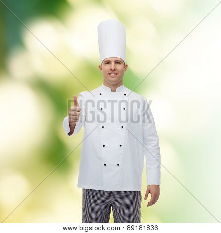 cooking, profession, gesture and people concept - happy male chef cook showing thumbs up over green background