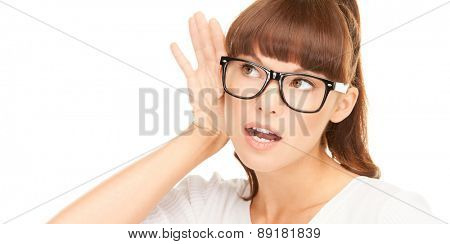 hearing and curiosity concept - closeup picture of young woman listening gossip