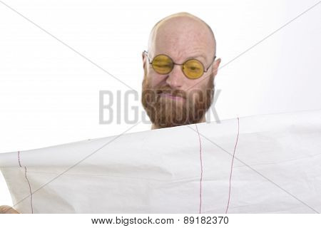 bald man reading with disgust isolated on white background