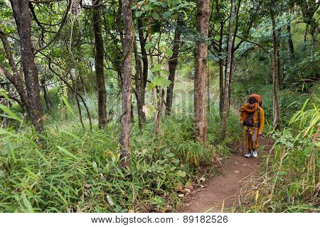 CHIANG DAO, THAILAND, JANUARY 05, 2015: A Buddhist monk is trekking to reach the top of the Chiang Dao mount for a new year meditation in Thailand.
