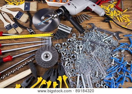 Working tools on wooden background