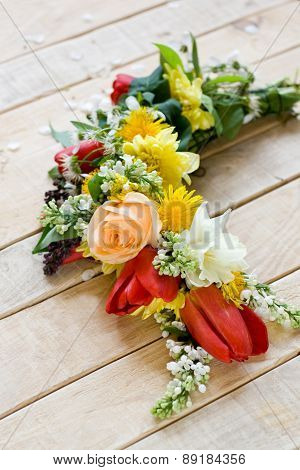 Bouquet Of Colorful Spring Flowers Lying On The Unpainted Wooden Background
